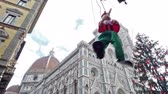 toscano : italy, puppet Pinocchio danced next to florence cathedral in christmas
