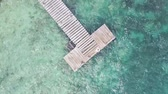 tentador : Wooden pier and blue waters around - screwdriver view shot from drone Stock Footage