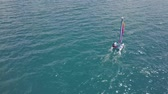 catamaran : BACALAR, MEXICO, 05 OCTOBER 2017: Catamaran sailing in blue waters - shot from drone