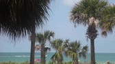 weather : Lido beach, Sarasota, Florida. people enjoy the beach, with fishing boat passing by