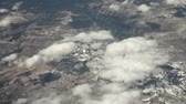 облака : Aerial view from an airplane over NevadaCalifornia somewhere in between Las Vegas and San Francisco, timelapse
