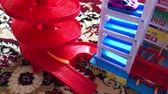 speelgoedauto : red balls roll with a toy roller coaster Stockvideo