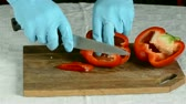 cut : cut up red pepper on the table