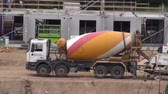 heavy : LITHUANIA, VILNIUS – MAY 29:concrete cement mixer truck lorry machine in building work place, May 29, 2014, Vilnius, Lithuania
