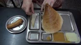 idli : tourist eating exotic food dosa in South india restaurant