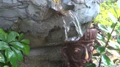 calm : old beautiful buddhist garden fountain with water splash and decorations Stock Footage