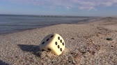 play : lucky game dice with number six points on summer resort sea beach sand Stock Footage
