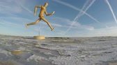 numaracı : wooden artist mannequin doll for drawing on old table and clouds motion in space. Timelapse 4K