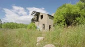 den : Old desolate building in the green meadow on breezy sunny day, time lapse 4 k