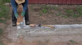 fieldwork : Builder placing wooden planks on anchors on cement foundation in summer