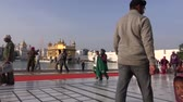 golden : Amritsar, India – December 16: Sikh pilgrims in Golden Temple  in December 16, 2012 , Amritsar, Punjab, India. Harmandir Sahib is the holiest pilgrim site for the world Sikhs.