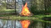Beautiful Spring  bonfire campfire near pond in park