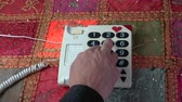 numerais : Man finger pressing numbers buttons on classic retro phone telephone on colorful tablecloth