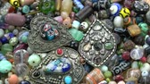 zawieszka : Rotating colorful various indian  ancient pendants on old  beads background Wideo