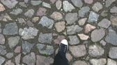 булыжник : Walking on old cobblestone road with plimsolls