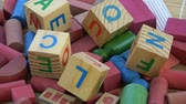 dilbilgisi : Rotating alphabetical and other toy wooden cubes background Stok Video