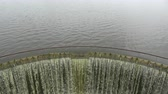 flowing water : Lake water falling in old dam construction after rain Stock Footage