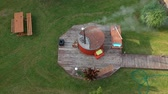 Outdoor bathhouse with hot water tub in yard, aerial view 무비클립
