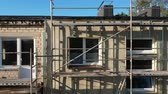 emelvény : Flat house with repair scaffolding, insulation works, aerial view