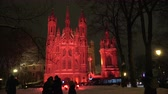 Vilnius light festival, Church of St. Anne in red light and peoples, 2019