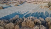 Beautiful autumn nature park landscape with groves and agriculture fields, early hoarfrost, aerial view