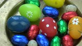 húsvét : Rotating  various colorful Easter eggs in brass plate, Easter background