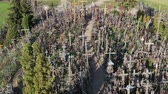 кресты : Lithuanian pilgrimage site iconic hill of crosses, aerial view