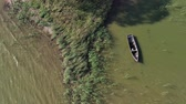 rybolov : Lonely old wooden fishing boat on sea water, aerial view Dostupné videozáznamy