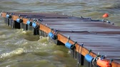 буй : New wooden empty pier and sea storm waves