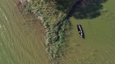 Lonely wooden fishing boat on sea lagoon water, aerial view