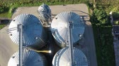industrial grain silos grain storage from drone, aerial view