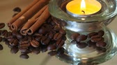Romantic background with coffee beans, cinnamon and candles Wideo