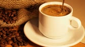 cup of coffee on a background . Spoon coffee mixes Wideo