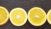 Appetizing orange circles lying on a wooden background. Camera wiring on top. Diet, food, healthy food.