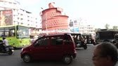 colorful : VARKALA, KERALAINDIA - DECEMBER 10 2011: pedestrian and traffic in the Indian city on December 10 in Varkala Stock Footage