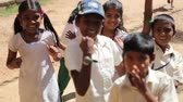 first class : VARKALA, KERALAINDIA - FABRUARY 13  2012: Indian kids are happy to see the white man for the first time in school on Fabruary 13 in Varkala