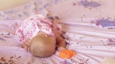 постельные принадлежности : child in pink dress play with toy on the bed