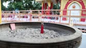 perfume : red fragrance sticks burn against Buddha temple