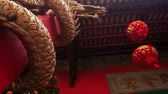 entwine : closeup camera moves around Chinese lantern and pile entwined with dragon at entrance to chinese temple in city Stock Footage