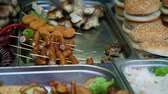 grate : abundance of assorted fried street food Stock Footage