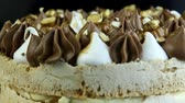 closeup panorama on Kiev cake with cream and nuts