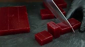 carmesim : confectioner cuts crimson marmalade into small pieces by knife Stock Footage