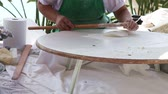 gozleme : Woman using a rolling pin to roll and smooth out her dough. Turkish pastry