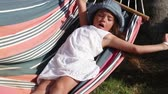 doze : Little girl sleeping in a hammock on a sunny summer day