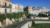 jellegzetes : Panoramic view of an amazing white city of Ostuni in Puglia, Italy Stock mozgókép