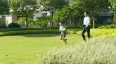 görme : Asian boy going through garden to school with his father