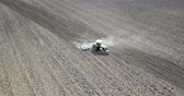 farming equipment : Tractor Field cultivation, Field preparation to plant, aerial view