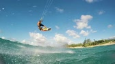 akrobatický : Young Man Kite Boarding in Ocean. Extreme Summer Sport in Slow Motion.