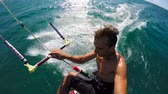 fitness : Extreme POV Shot of Young Man Catching Air Kitesurfing in Slow Motion HD. Stock Footage