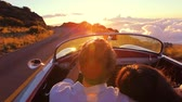 Happy Couple Driving on Country Road into the Sunset in Classic Vintage Sports Car. Steadicam Shot with Flare. Romantic Freedom Love Concept. Vídeos